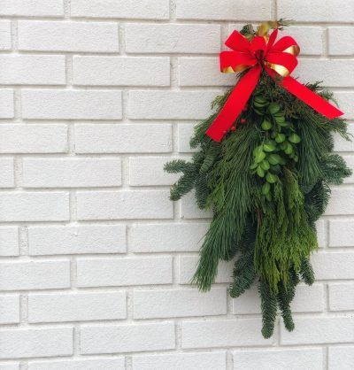 A simple mistletoe wreath with red bow