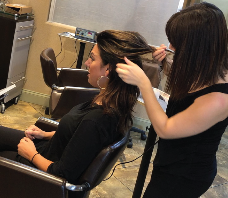 A woman getting their hair done at Oksana